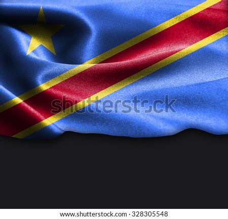 Democratic Republic of the Congo flag on smooth silk texture Dark Background Space for Text - stock photo
