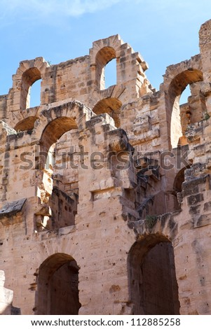 Demolished ancient walls and arches of ruins in Tunisian Amphitheatre in El Djem, Tunisia - stock photo