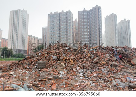 demolished house and High-rise - stock photo