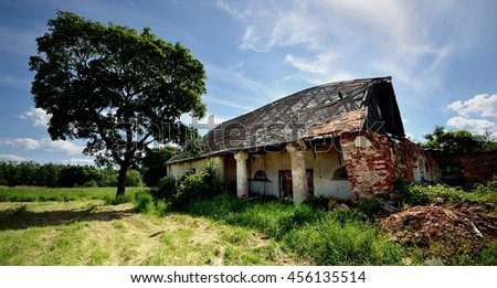 demolished old shed in the countryside - stock photo
