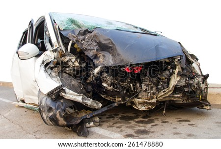 Demolished white car which collided with a tree accident severely damaged. - stock photo