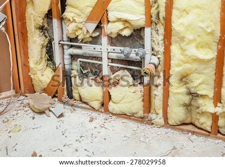 Demolishing a residential bathroom at the beginning of a remodeling project - stock photo