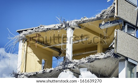 demolishing at a construction site - stock photo