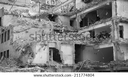 Demolishing building - stock photo