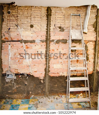 demolition debris in kitchen interior construction and ladder - stock photo