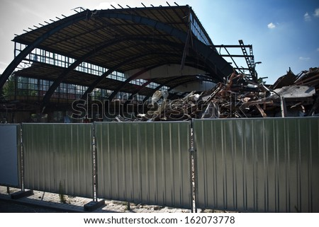 Demolition of building and stack of rubble and scrap - stock photo