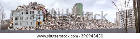 Demolition of buildings in urban environments. House in ruins. - stock photo