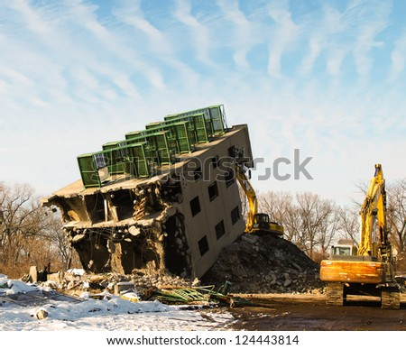 Demolition of old abandoned fireman's practice tower - stock photo