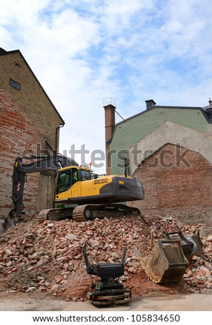 Demolition of old city house in vertical view - stock photo