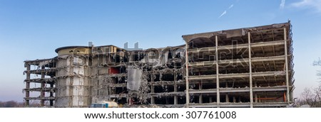 demolition of old industrial building - stock photo