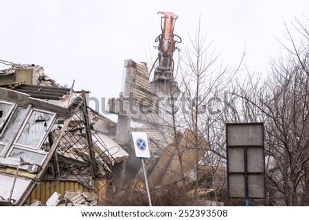 Demolition of the old factory building - stock photo