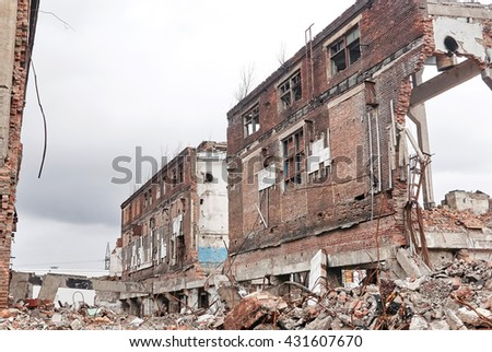 demolition of the remaining old buildings on the territory of the former factory - stock photo