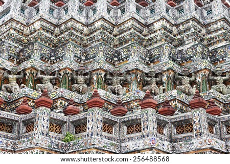 Demon Guardian statues decorating the Buddhist temple Wat Arun in Bangkok, Thailand  - stock photo