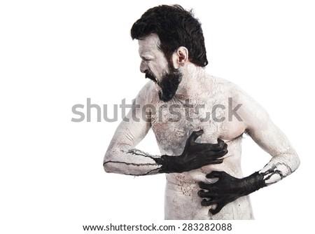 Demon in pain - stock photo