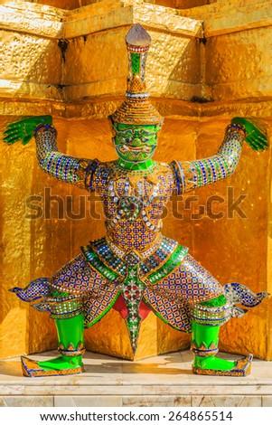Demon, mythical creature guarding the Golden Stupa also known as Phra Sri Ratana Chedi - Wat Phra Kaeo Bangkok, Thailand - stock photo