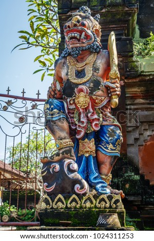Demon statue at a Pura Dalem (Temple of the Dead) entrance, Canggu, Bali Island, Indonesia
