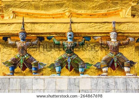 Demons, mythical creatures guarding the Golden Stupa also known as Phra Sri Ratana Chedi - Wat Phra Kaeo Bangkok, Thailand - stock photo