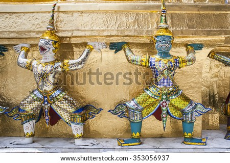 Demons mythical creatures guarding The Golden Stupa at Grand Palace in Bangkok. Thailand.