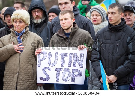 Demonstration against Putin's intervention in Crimea and separation of Ukraine. People stand for peace and unity at Taras Shevchenko monutent on his 200 years anniversary on 9 of March 2014 - stock photo