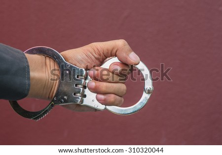 Demonstration held in handcuffs and shackles to take action against those who broke the law.  - stock photo
