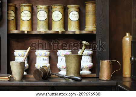 Demonstration of ancient apothecary interior; Museum of Medicine History - stock photo