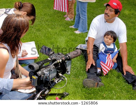 Demonstrators at Los Angeles illegal emigrant rally being interviewed, May 1st 2006 - stock photo