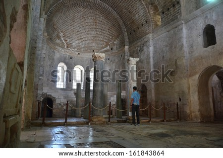DEMRE, TURKEY - JUNE 27: Man stands alone in the ancient byzantine church of St Nicholas remembering a lost civilisation:  June 27, 2013 in Demre, Turkey