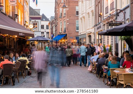 DEN BOSCH, NETHERLANDS - MAY 8: People having a drink in evening in the city center of Den Bosch, Noord-Brabant, in the historical and characteristic town, on May 8, 2015, in Den Bosch,  Netherlands - stock photo