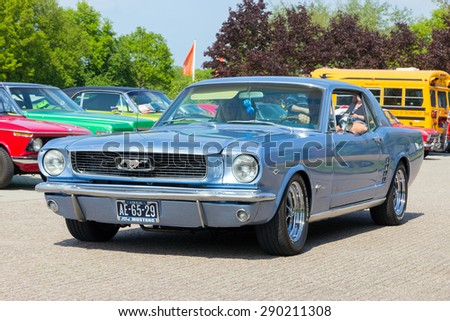 DEN BOSCH, THE NETHERLANDS - MAY 10, 2015: 1966 Ford Mustang on the parking lot at the Rock Around The Jukebox event. - stock photo