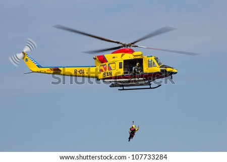 DEN HELDER, THE NETHERLANDS - JULY 7: AB412 helicopter rescue demonstration during the Dutch Navy Days on July 7, 2012 in Den Helder, The Netherlands - stock photo