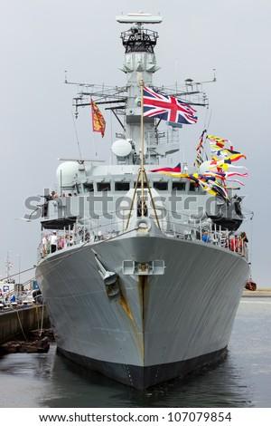DEN HELDER, THE NETHERLANDS - JULY 7: British Royal Navy frigate HMS Lancaster open for visits during the Dutch Navy Days on July 7, 2012 in Den Helder, The Netherlands - stock photo