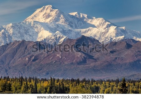 Denali, formerly Mount McKinley, rises above the autumn taiga - stock photo