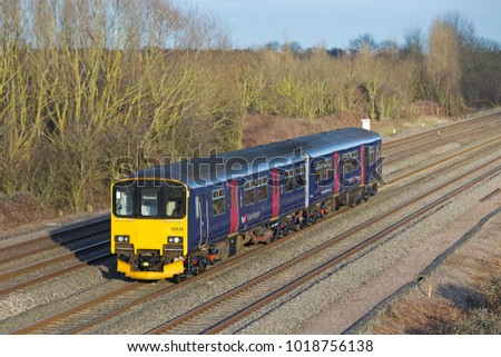 DENCHWORTH, UK - FEBRUARY 19: A GWR operated pacer unit heads toward Cornwall on a stock transfer movement to operate on rural commuter services on February 19, 2014 in Denchworth