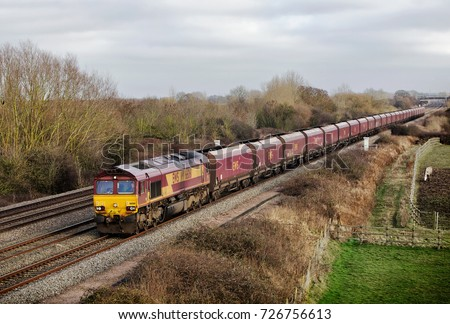 DENCHWORTH, UK - JANUARY 11: A DBS operated coal freight train heads back toward the depot to be refilled as part of the MGR service to the power station at Didcot on January 11, 2013 in Denchworth