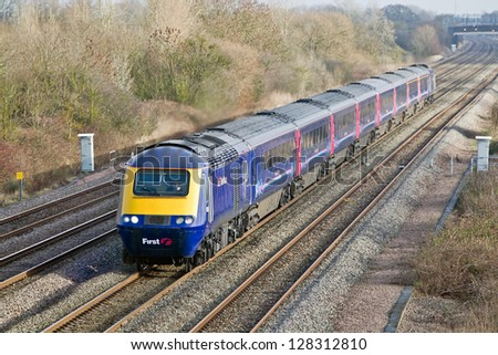 DENCHWORTH, UK - JANUARY 11: An HST125  passes through Denchworth on January 11, 2013 in Denchworth. 197 HST units were built between 1975-82 and are still in mainline passenger service 38 years later - stock photo