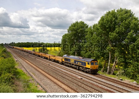 DENCHWORTH, UK - MAY 28: A GBRf operated sand train passes through Denchworth on route to London on May 28, 2015 in Denchworth. GBRf, founded in 1999 operates a fleet of 120 locos