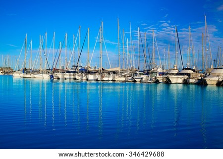 Denia marina port in Alicante Spain with boats in a sunny blue day - stock photo