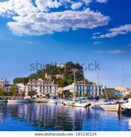 Denia Port with castle hill and marina boats in Alicante province Spain - stock photo
