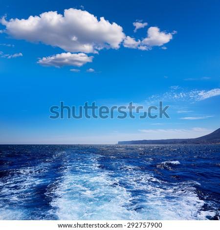 Denia San Antonio Cape in Alicante sailing with boat wake at Spain - stock photo