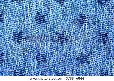 Denim blue jeans with star stamp print background, close up, fashion background - stock photo