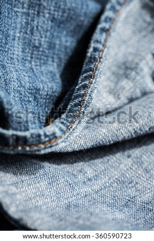 Denim Fabric, Jeans Fabric. Concept and Idea of Denim Industry, Sewing and Fashion. Pattern, Background, Wallpaper and Textured. Selective, Close up Shot.