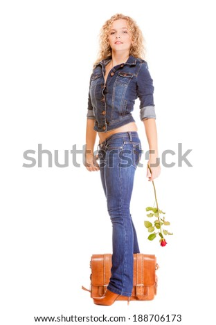 Denim fashion. Full length college university student girl with bag and red rose, casual woman in stylish blue jeans pants and jacket high heels. Isolated on white background