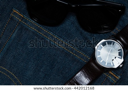 denim jean with sunglass and watch.