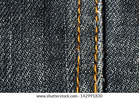 denim jeans fabric detail with seam - stock photo