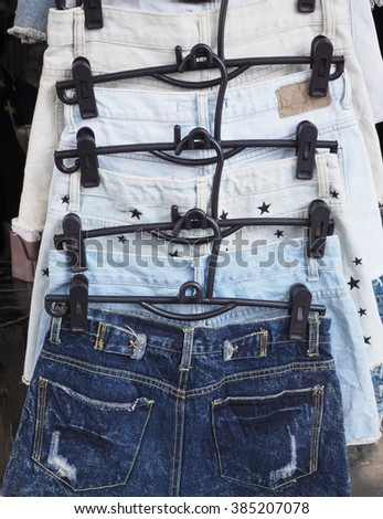 Denim jeans on clothes hanger in the shop - stock photo