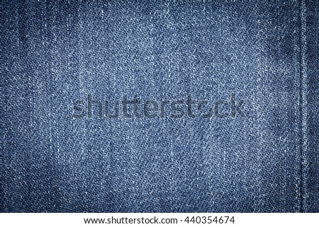 Denim jeans texture background with seam of fashion jeans design with copy space for text or image. Dark edged. - stock photo