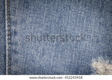Denim jeans texture or denim jeans background with seam and old torn of fashion jeans design with copy space for text or image. Dark edged. - stock photo