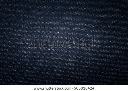 Denim jeans with dark blue shade. Vintage Texture for background.