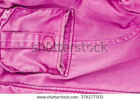 Denim texture fabric with pockets background Pink colour