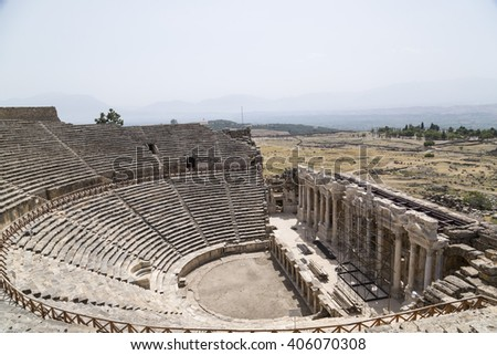 Denizli, Turkey - September 7, 2015: Ruins of the ancient Phrygian city of Hierapolis in Pamukkale, southwest Turkey. The historical site is a popular cultural destination for tourists.